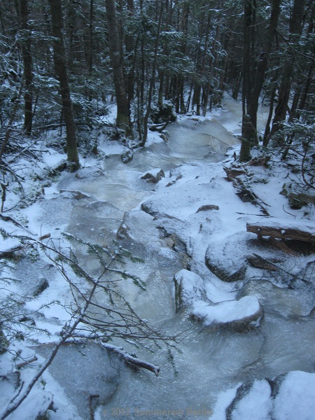 The ice flows continue even past the section near the ski trail.  Santa, lots and lots of snow would cover this up.  Could you send about 3 feet worth?
