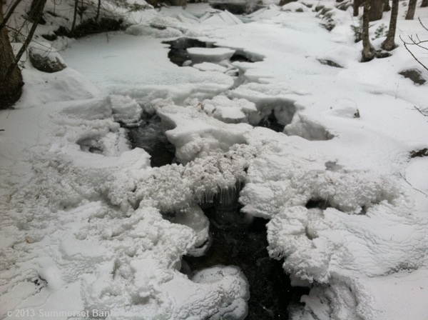 Looking upstream at the snow and ice formations at the bridge between Dicey's Mill Trail and Blueberry Ledge Cutoff.