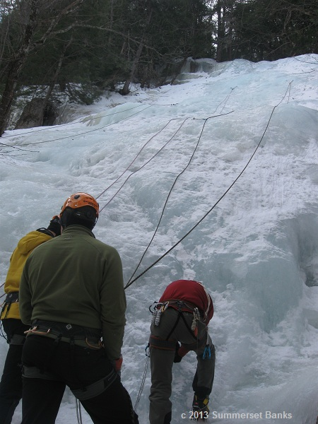 First ice climb.  Our guide, in the center, is getting the anchors and ropes set while two of my classmates watch.