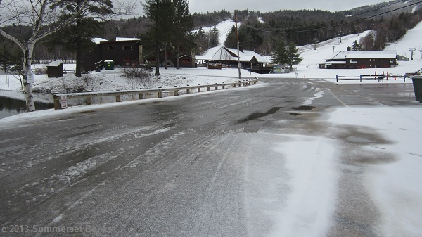 Looking back to the main lodge and parking area at Gunstock from the same point on the road as the previous photo.