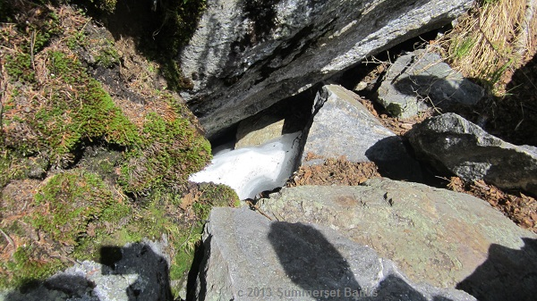 Snow and ice still among the boulders on the floor of the ravine.
