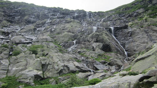 A look up to the many cascades of the headwall of the ravine.