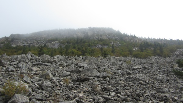 The cliffs of Whitewall Mt. rising out of the mists above the Ethan Pond Trail.