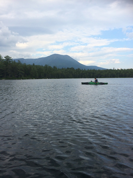 Cameron paddling on Daicey Pond, with Katahdin in the background.