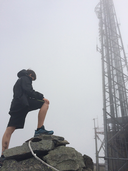 Cameron with one of the communications towers on Sugarloaf.