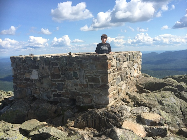 Cameron in the foundation of the firetower that was once on Avery Peak.