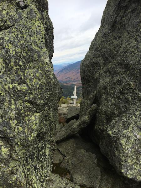 Looking through Split Rock, a huge split boulder on the Boott Spur Trail.