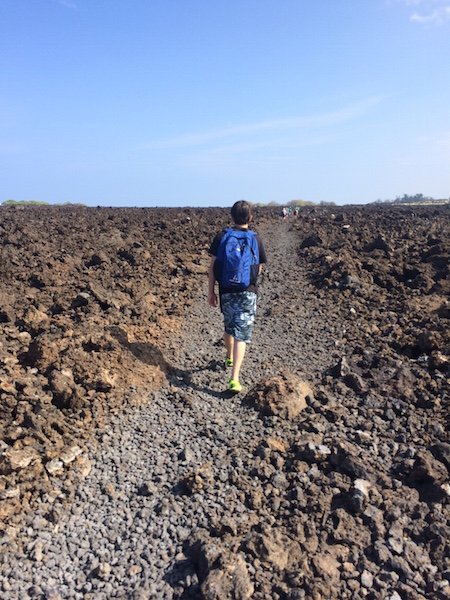 Hiking through the lava field to the next beach.  Some people were walking on this in flip-flops!