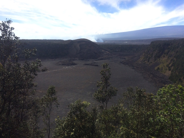 A peek into the Kilauea Iki Crater from the trail along the rim.  The trail can be seen along the floor of the crater.