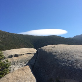 A lenticular clouds forming over the Presidentials as seen from near the pothole rocks on Caps Ridge Trail.